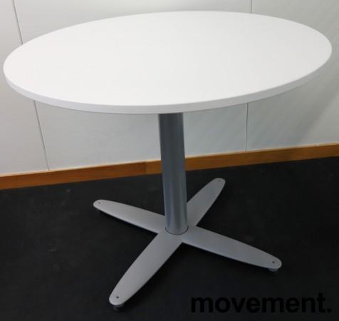 Lite, rundt møtebord med hvit bordplate fra Kinnarps T-serie, Ø=90cm, H=72cm, grått understell, pent brukt
