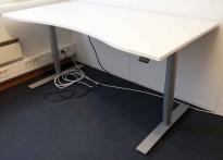 Kinnarps Oberon elektrisk hevsenk skrivebord i hvitt, understell i lysegrått, 160x80cm, magebue, pent