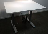 Skrivebord med elektrisk hevsenk i hvitt / grått, 100x80cm, pent brukt understell med ny plate