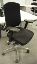 Sitland kontorstol i sort stoff, med armlene, pent brukt